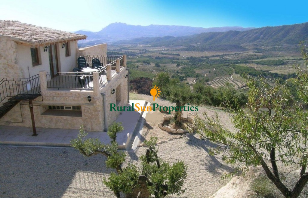 Country House with stunning views over the surrounding valley and mountains.